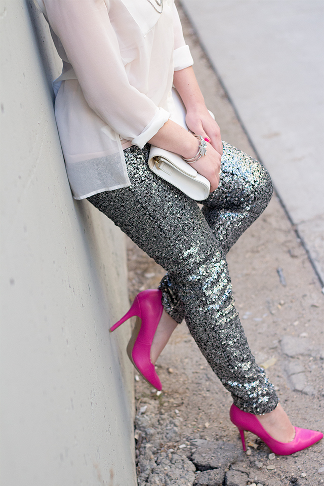 Sequinned pants with hot pink high heels.