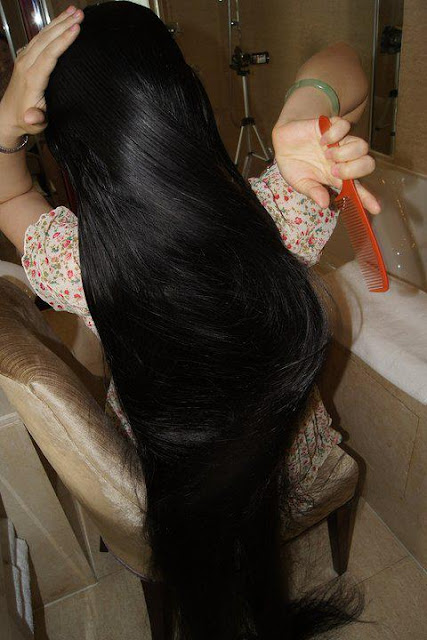 Combing smooth silky black hair