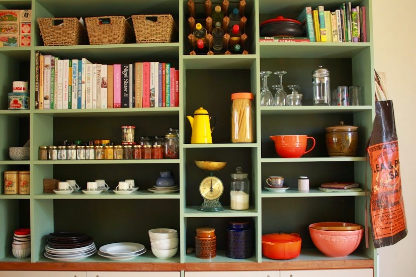 Pictures from the kitchen of the Cafe Cat - shelves filled with spices, pots and ceramics