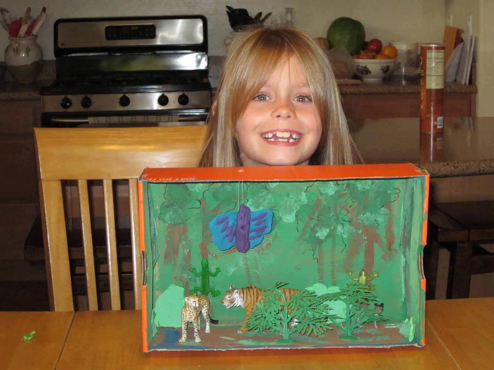Here is liv with her finished tropical rainforest she did all the