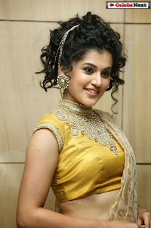 Actress Tapsee Pannu Pictures in Golden Saree at Elite Designer Fashion Show 0006