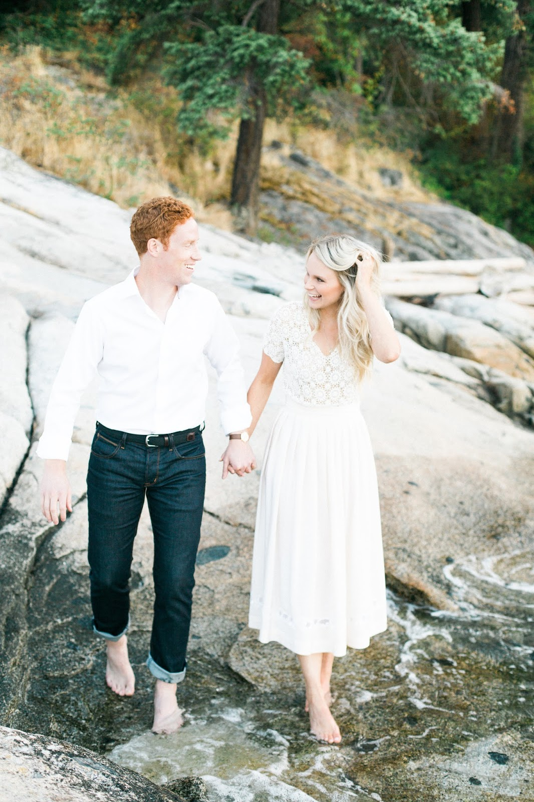 dipping our feet in the water during engagement photos
