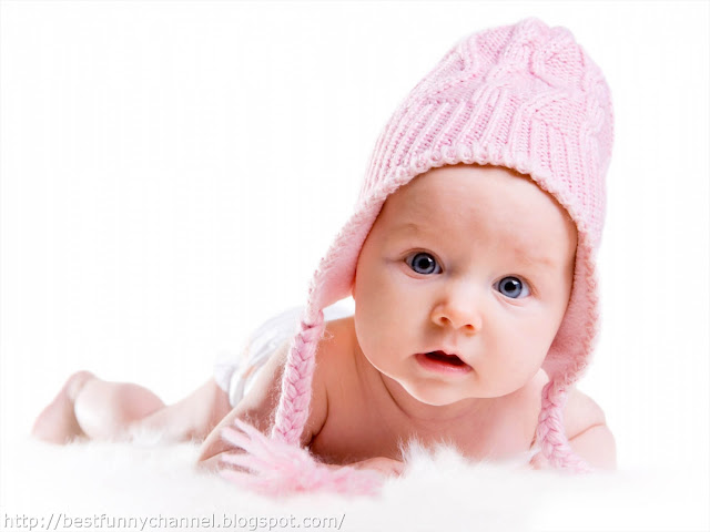 Cute baby in a pink cap.