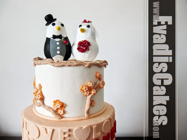 Pastel orange wedding cake with birdie on top