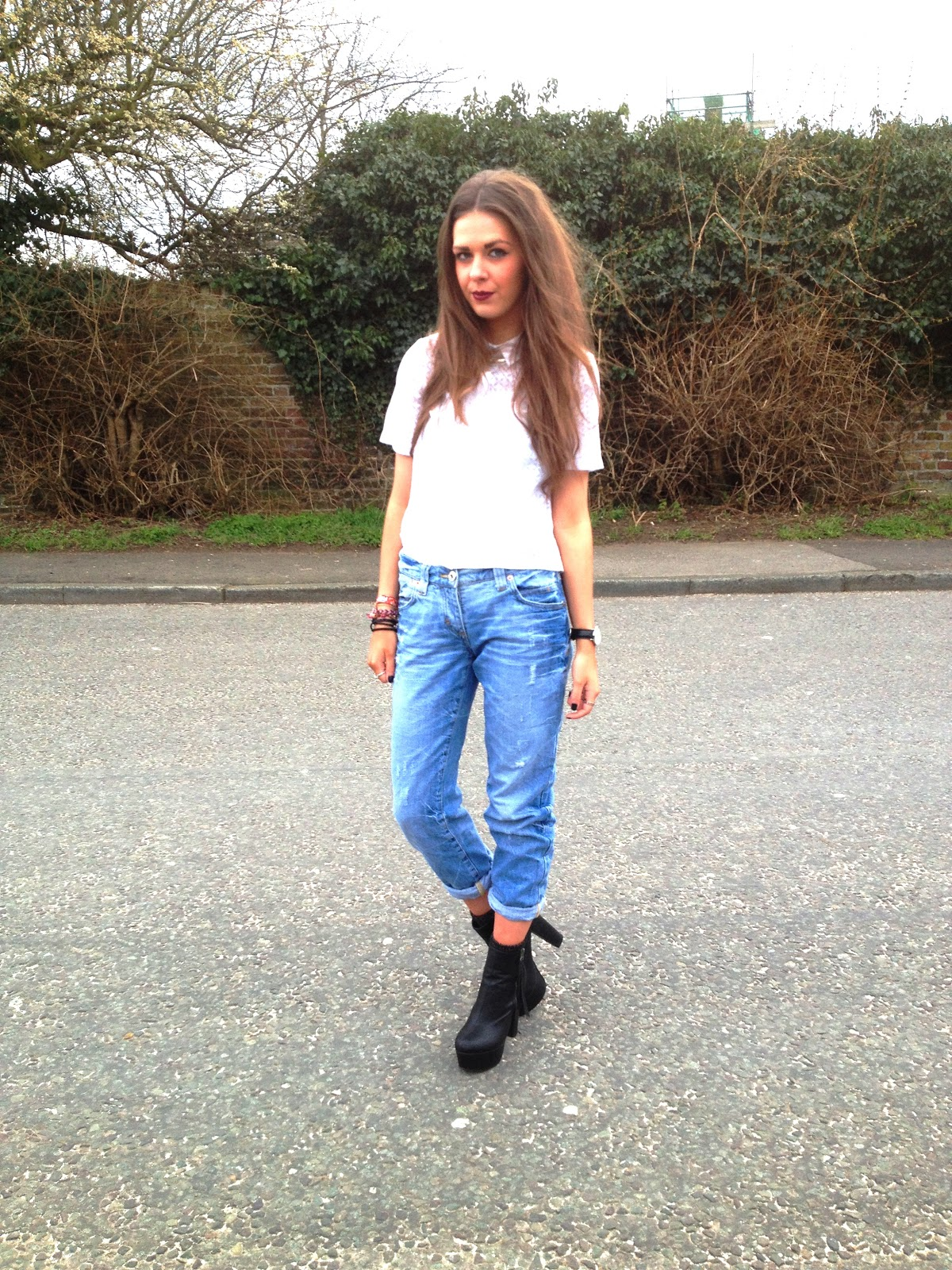 Fashion image of blogger wearing jeans and heels trend