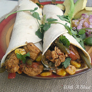 Spicy Mexican Chicken Wraps ~ Spicy Chicken and Mexican Vegetables wraps which is perfect to serve during the cooler days as lunch or dinner {quick and easy too!} #ChickenRecipe #ChickenWrap #MexicanWrap www.WithABlast.net