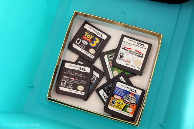 How to Organize Kid's Video Games www.lovegrowswild.com #organize #kids #games #storage