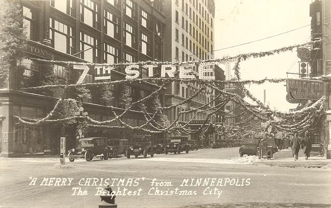 Christmas decorations at 7th Street and Nicollet Avenue. Dayton department  store on left, 1920s