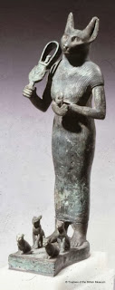 Egyptian cat goddess with her musical instrument the sistrum resembling a fiddle