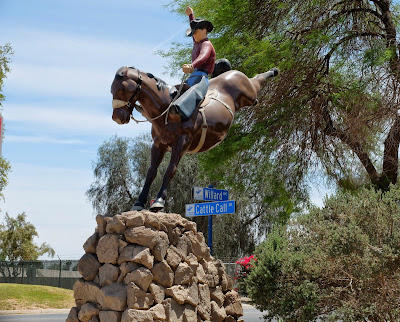 Photos of the statue at the entrance to the River Park / Cattle Call Arena