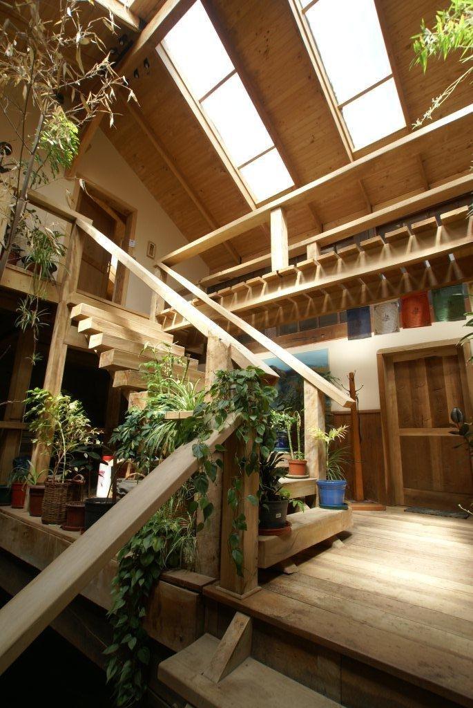 Palacio en madera al sur del mundo pasillos y jardines for Jardines interiores