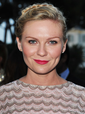 Kirsten Dunst adds a fun twist to her pulled back 'do with a small braid in the back