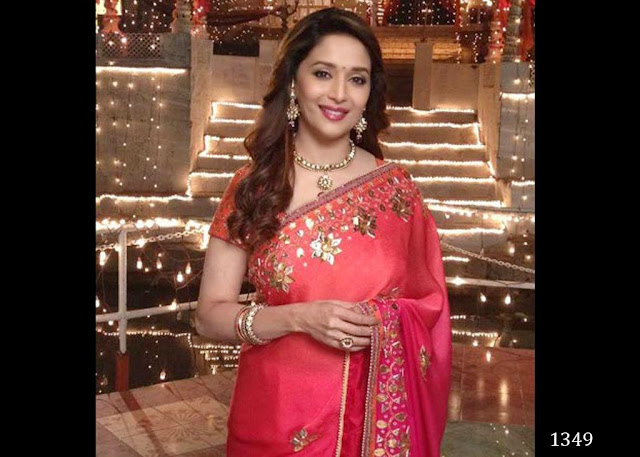 1349-Madhuri Eternal beauty Madhuri Dixit Nene spotted in an alluring red colour saree.