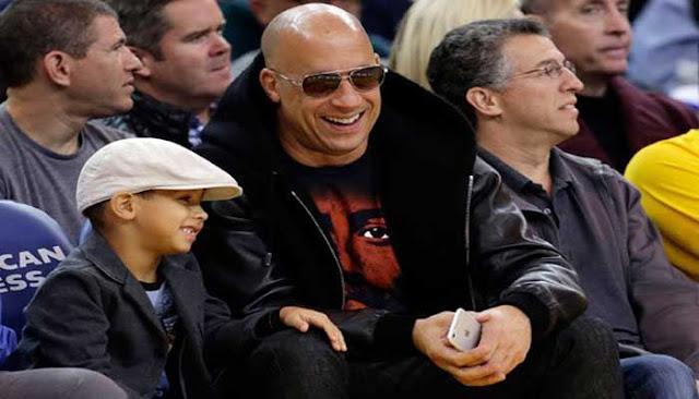بالصور.. فان ديزل يحضر مباراة لكرة السلة مع ابنه