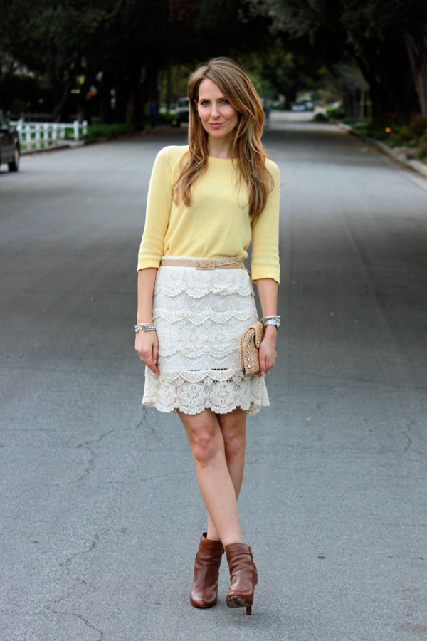 yellow sweater tucked into lace skirt
