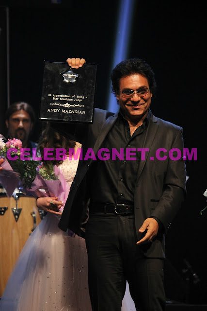 Singer Andy Madadian receives an award at Star Musician finale in Los Angeles