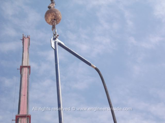 Crane hook on the test pile