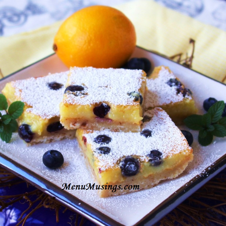 These dainty Meyer lemon bars are made extra special with the addition ...