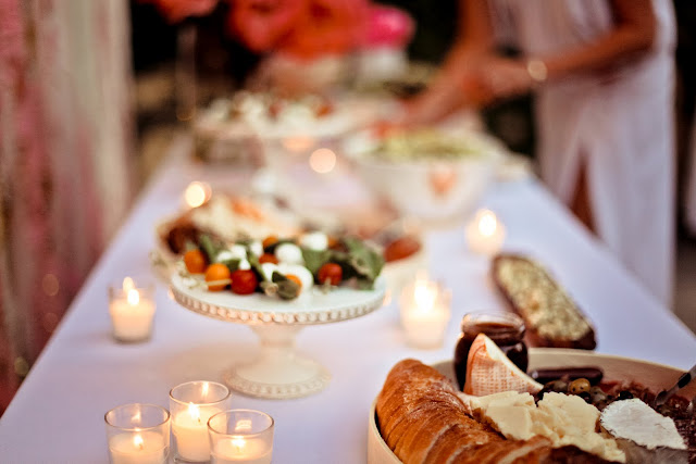 hors d'oeuvres, cheeses and vegetables spreads with votive candles