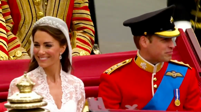 The weds, Catherine smiles happily on the carriage. YouTube 2011.