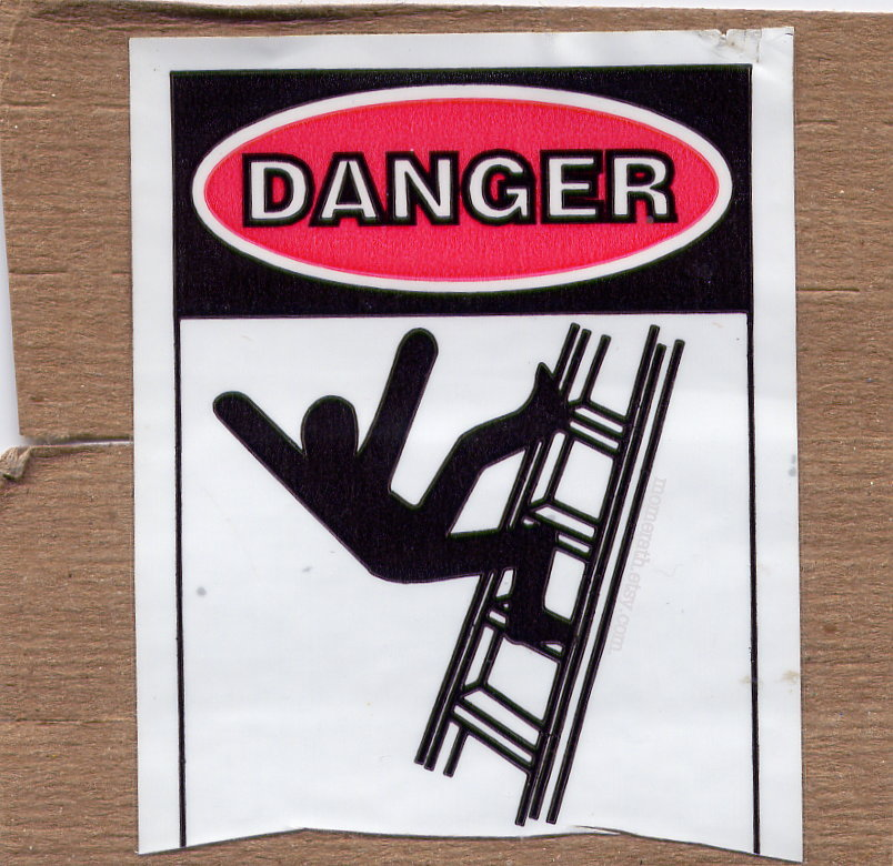 a warning sign with an illustration of a figure falling off a ladder