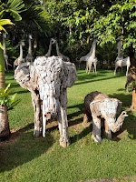 view of gardens and elephant sculptures made out of wood