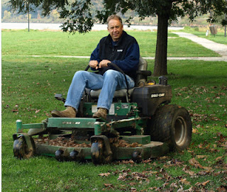 leaf mulching in action - riding a mulching mower in the park