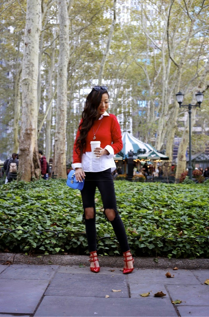 lucca couture sweater,red sweater,holiday outfit, holiday outfit ideas, holiday essential, unif jeans, valentino rock studs, valentino lock bag, babublebar 360 pearl studs earrings, alexander mcqueen skull necklace, karen walker sunglasses, New york city, fashion blog, street style, holiday, bryant park, city view, shallwesasa
