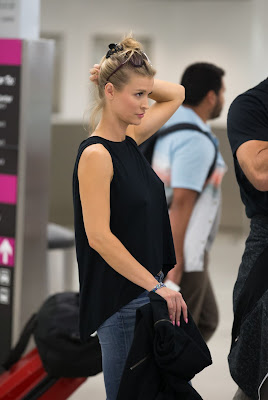 Joanna Krupa in a casual attire at Miami Airport with her husband