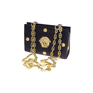 Vintage 1990's black and gold Gianni Versace handbag with gold chain strap and hardware.