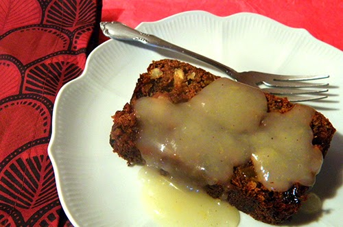 Slice of Persimmon Pudding with Lemon Sauce