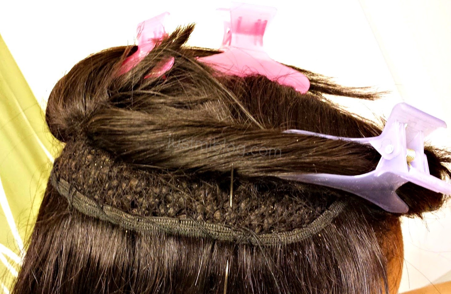 re-sewing extensions or track into natural hair