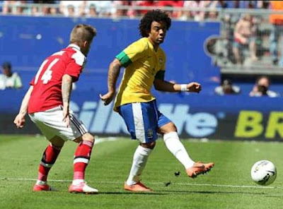 Marcelo playing for Brazil against Denmark