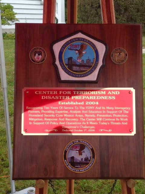 Center for Terrorism and Disaster Preparedness 10 year anniversary plaque.  Custom fire helmet shield provided by FirefighterShields.com
