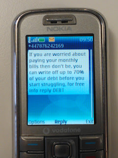 Fake Debt Writeoff SMS Text Message Scam
