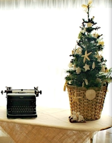 potted mini Christmas tree with coastal ornaments