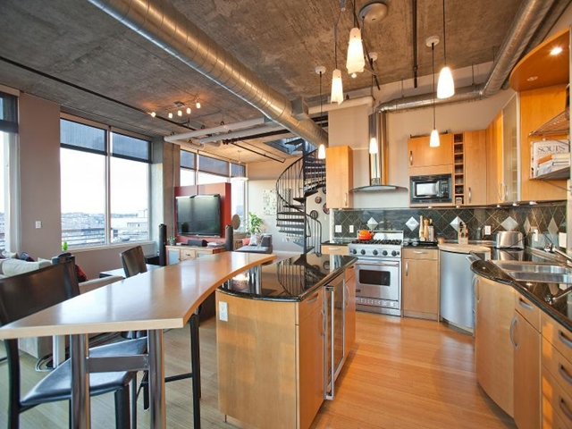 Loving room in Denver penthouse apartment as seen from the kitchen