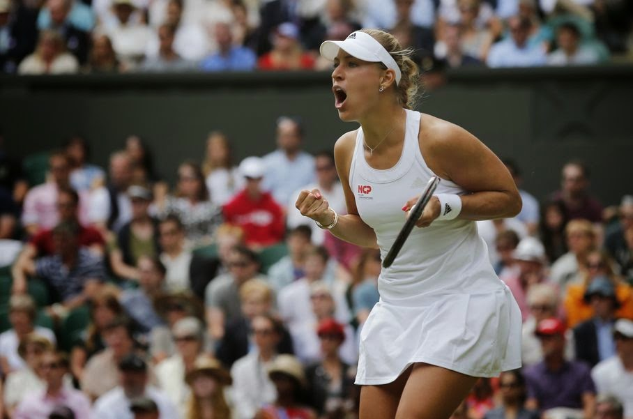 Angelique Kerber of Germany celebrates winning a point against Maria Sharapova of Russia during their women's singles match at the All England Lawn Tennis Championships in Wimbledon, London, Tuesday, July 1, 2014.