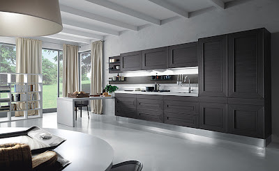 modern kitchen in black and white with cabinets all the way to the ceiling