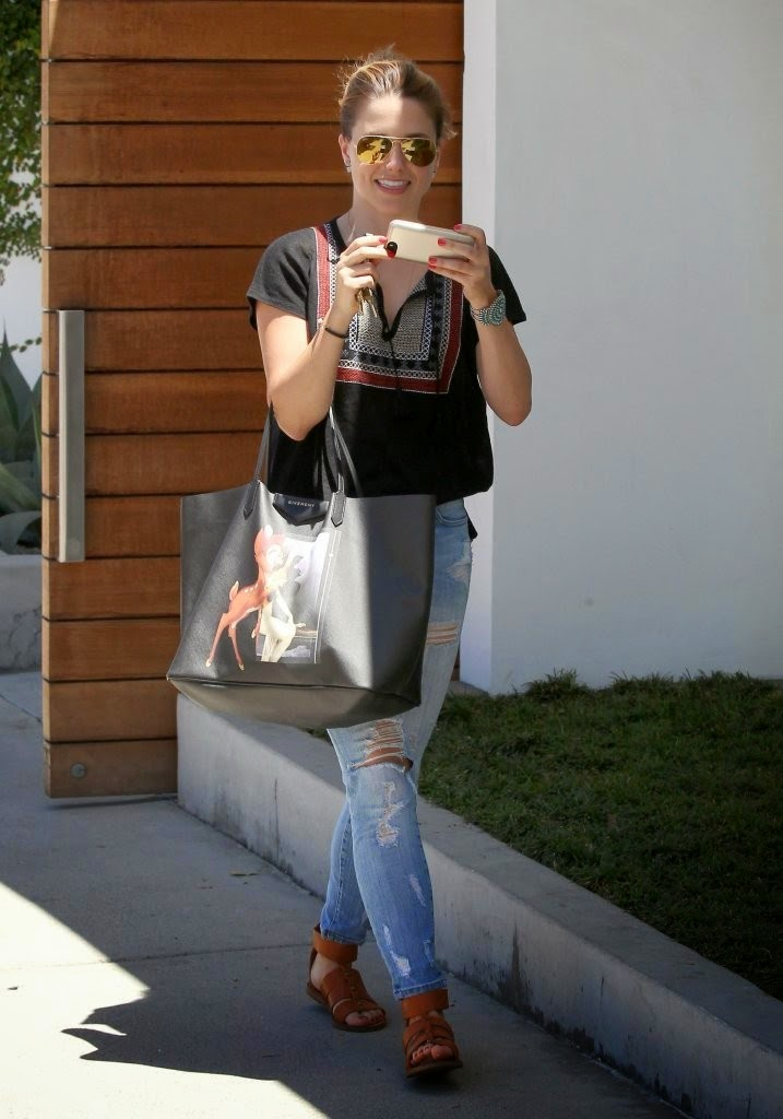 Sophia Bush in a traditional blouse and ripped jeans