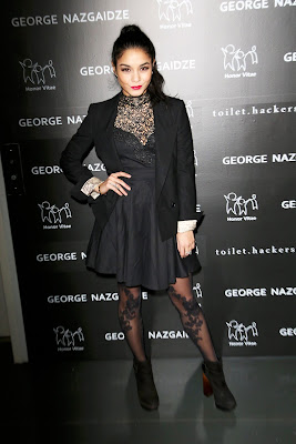 Vanessa Hudgens wearing fit-and-flare dress with a matching blazer, booties, and tights which had a sexy vine pattern scaling her legs