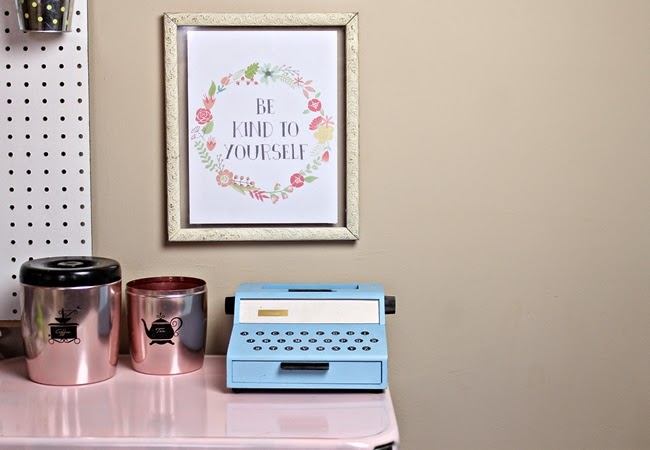 vintage style home office with pink kitchen canisters and toy typewriter