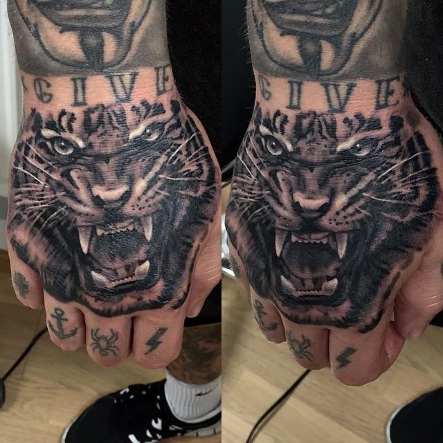 Tattoo geek ideas for best tattoos animal tattoo for Animal hand tattoos