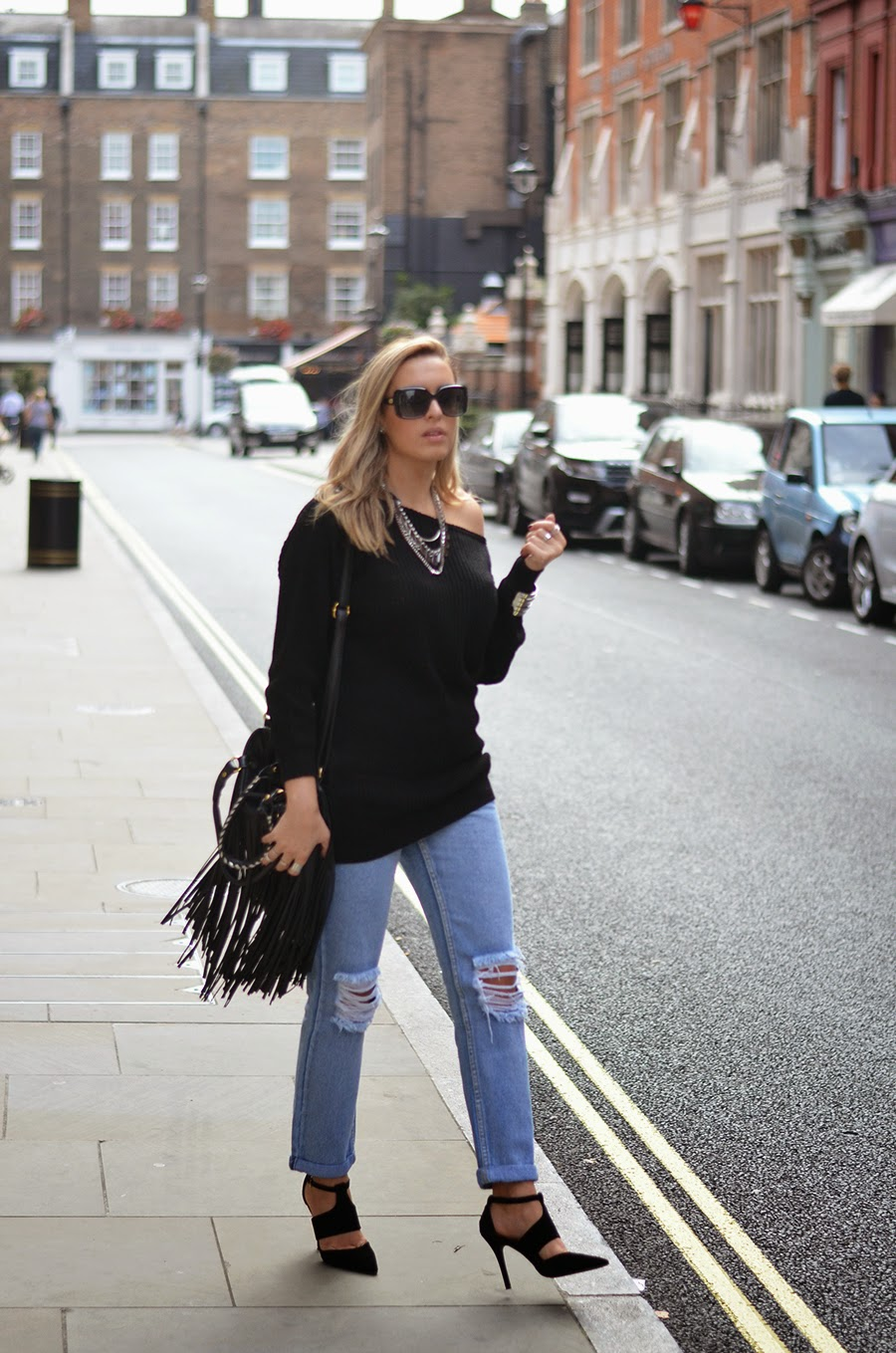 off the shoulder jumper and ripped jeans