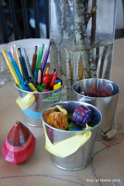 bundles of crayons on a craft paper table for dinnertime crafting to keep kids at the table!
