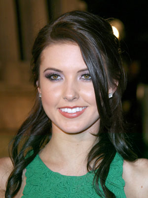 Audrina Patridge dresses up her long hairstyles with shiny coils that are pinned back on the sides.