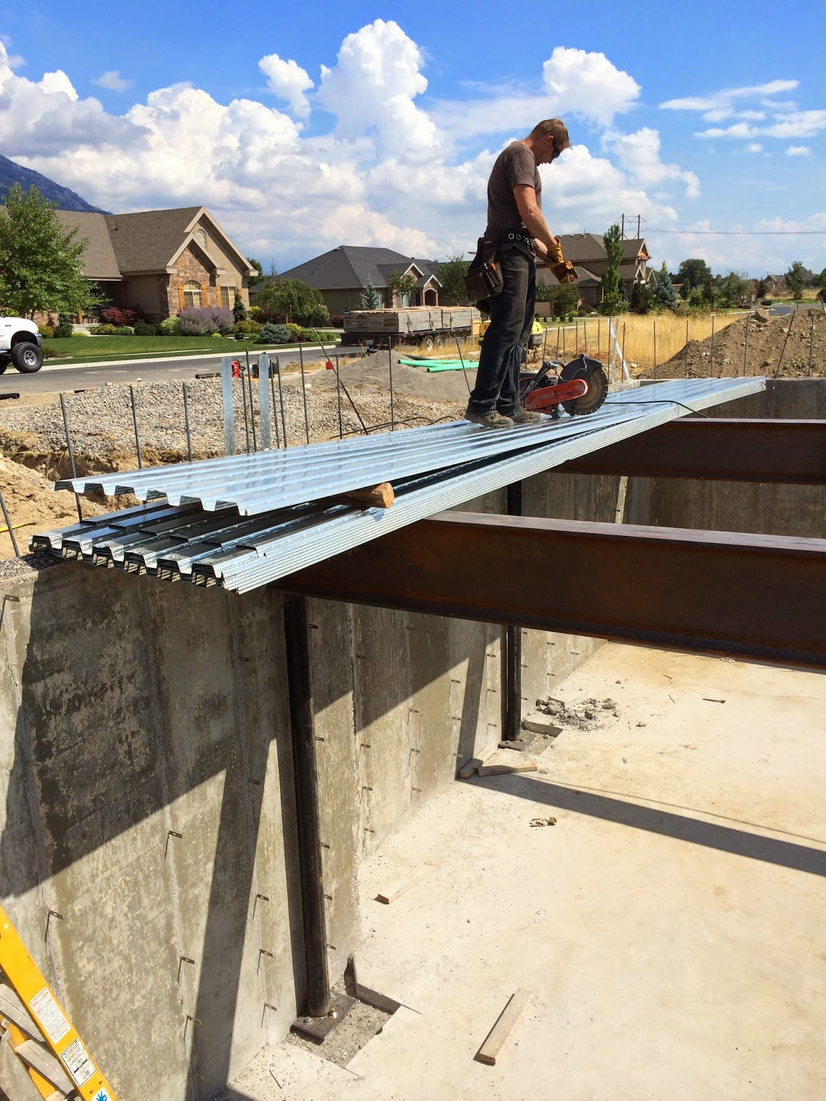 Energy efficiency house b deck and basement slab complete for Suspended concrete floor