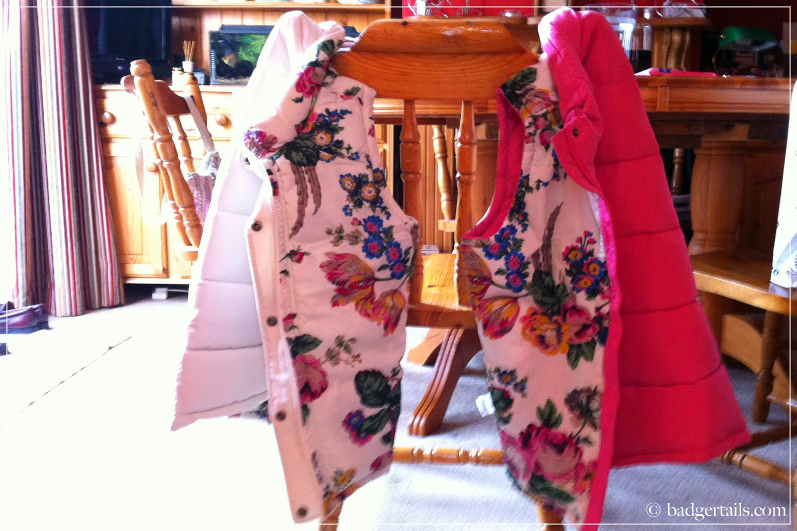 two joules gilet pink and white hung on chair of country house