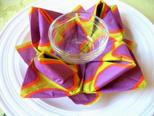 http://acupofsparkle.blogspot.com/2011/07/water-lily-napkin-folding-tutorial-for.html