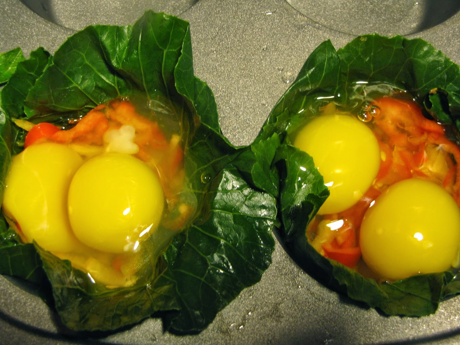 Eggs and Peppers assembled in collard green cups before baking